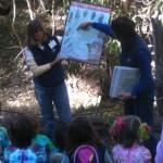 Docents lead a school field trip.